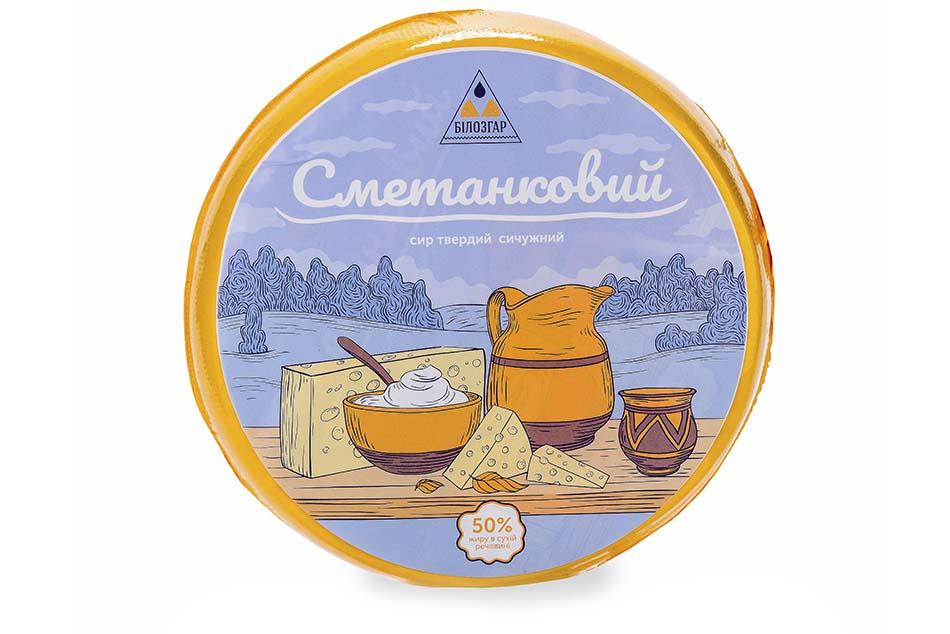 Сыр сычужный твёрдый Сметанковый 50% жира фото